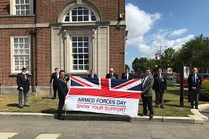 Councillors Dan Land and Chris Amos with the Armed Forces Day flag at Clacton Town Hall, with Clacton Royal British Legion veterans present
