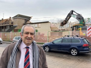 Councillor Carlo Guglielmi outside Honeycroft as demolition begins