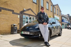 Electric taxi with owner Mr Bennett