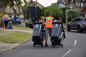 Wheelie bins being delivered