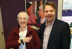 Jean Allen shows off her new Alarm watch at Home Instead Frinton with Mark Westall
