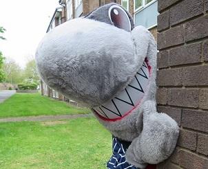 Sid the Shark, the mascot of the England Illegal Money Lending Team.
