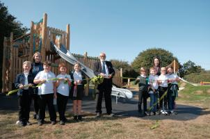 Councillor Talbot with Kirby Primary Academy pupils at the reopening of Kirby Cross playground