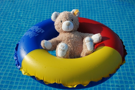 Bear in a swimming ring