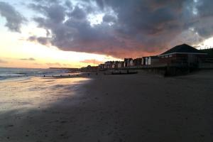 Dramatic sky over Walton on the Naze by Michael Cross