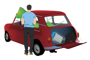 Picture of red car containing items for recycling centre for household waste