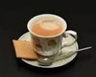 Coffee cup and biscuit