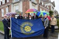Tendring District Council Vice-Chairman councillor Karen Yallop with the Commonwealth Flag, watched on by other councillors