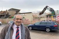 Councillor Carlo Guglielmi outside Honeycroft as demolition begins