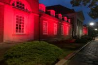Princes Theatre lit in red