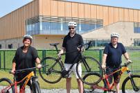 Councillor Sue Lissimore, Councillor Alex Porter and Councillor Paul Dundas with bikes at Colchester Northern Gateway