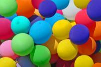 Photograph of multi-coloured balloons