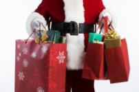 Father Christmas with christmas presents in bags