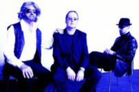 Blue and white photo of the three band members
