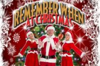 Neil Sands and two female singers in red Santa type costumes