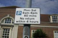 Parking restriction sign on a lamp post